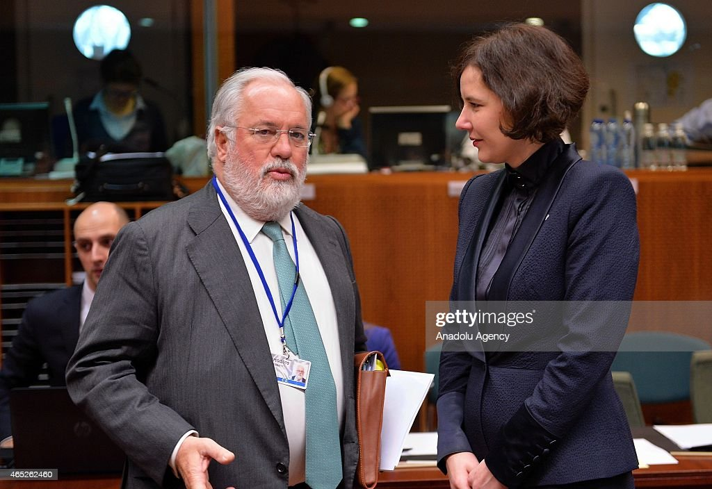 EU Commissioner for Climate Action and Energy, Miguel Arias Canete (L) talks with Latvian Minister for Economy, Dana Reizniece-Ozola (R) prior to the EU Energy Ministers' meeting at the EU Commission headquarters in Brussels, Belgium, on March 05, 2015.