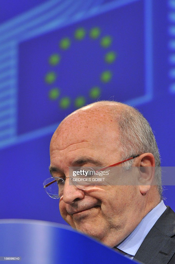 EU commissioner for Competition Joachim Almunia gives a press conference on state aid decisions on Group 2 Spanish banks on December 20, 2012 at the EU Headquarters in Brussels. The European Commission cleared restructuring plans and aid for four small Spanish banks as part of efforts to stabilise the country's stricken banking system. Banco Mare Nostrum, Banco Caja 3, Liberbank and CEISS were classed as Group 2 banks, meaning they were 'unable to meet their capital shortfall without having recourse to state aid,' a statement said. GOBET
