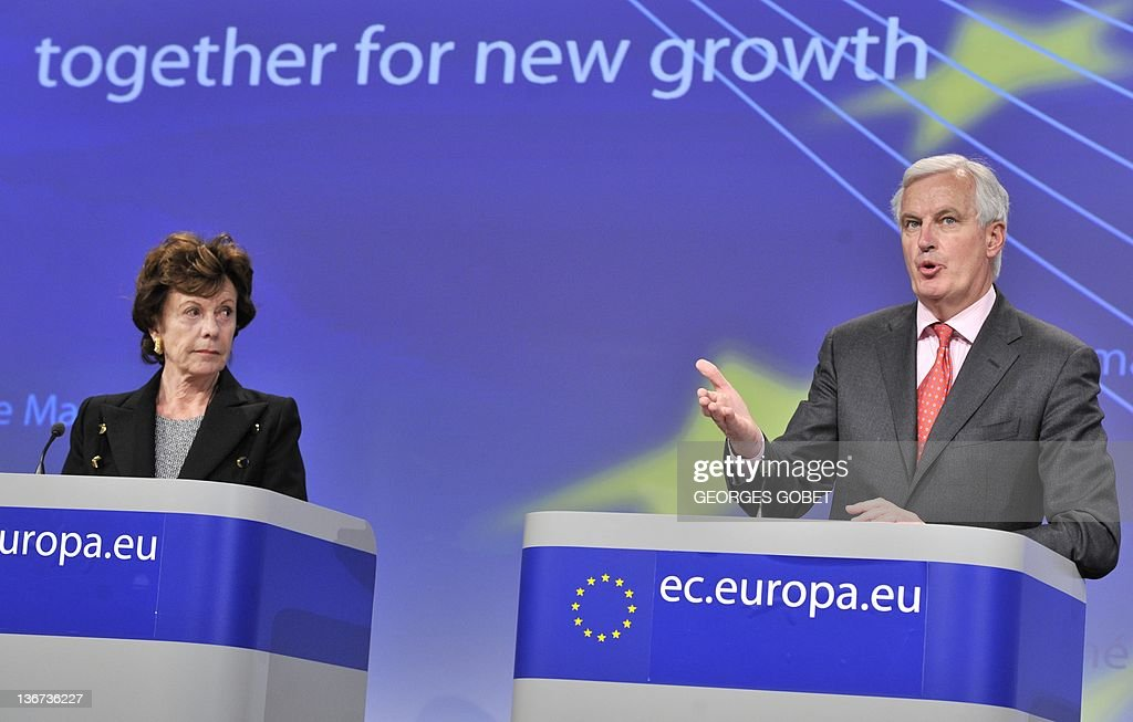 EU commissioner for Digital Agenda Neelie Kroes (L) looks on as EU commissioner for Internal Market and Services Michel Barnier speaks during a press conference on breaking down barriers to secure and innovative card, internet and mobile payments and an Action plan to double the share of the Internet economy in Europe by 2015 on January 11, 2012 at the EU Headquarters in Brussels. AFP PHOTO/GEORGES GOBET