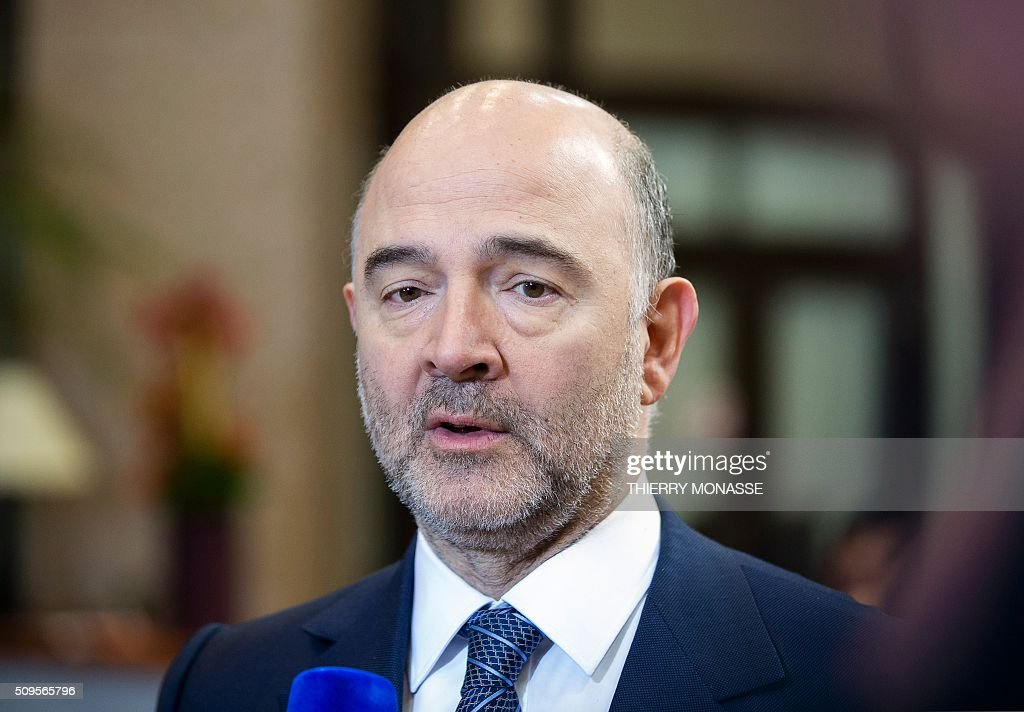 EU Commissioner for Economic and Financial Affairs, Taxation and Customs Pierre Moscovici talks to the media prior to a meeting of Eurogroup ministers at the European Council headquarters in Brussels on February 11, 2016. / AFP / THIERRY MONASSE
