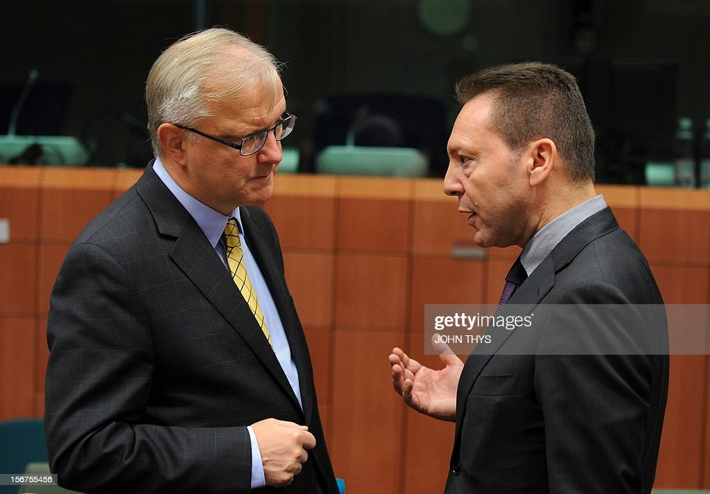 EU commissioner for Economic and Monetary Affairs Olli Rehn (L) speaks with Greek Finance Minister Ioannis Stournaras (R) before an Eurozone finance ministers meeting to decide on a fresh rescue loan for debt-stricken Greece, on November 20, 2012 at EU headquarters in Brussels. Greece has 'delivered' on reform and a deal will likely be clinched to unblock funds to keep it from bankruptcy, the head of the Eurogroup insisted despite a split with the IMF over how to get the stricken country's economic recovery on track.