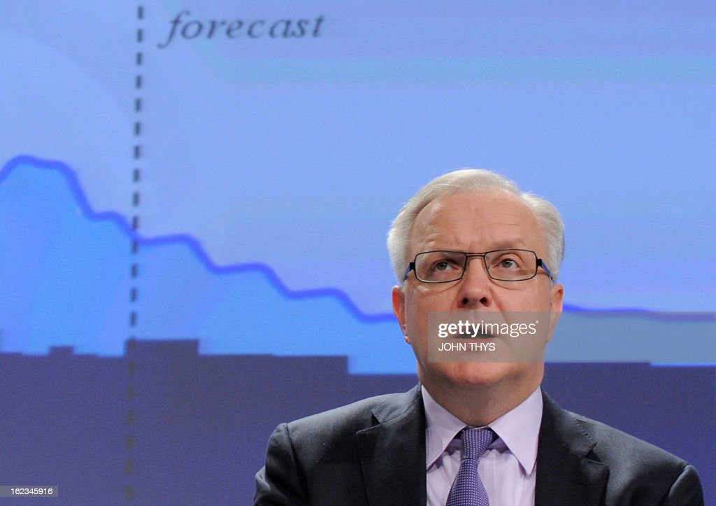 EU Commissioner for Economic and Monetary Affairs Olli Rehn talks on February 22, 2013 during a press conference on the European Economic Forercast at the EU Headquarters in Brussels.