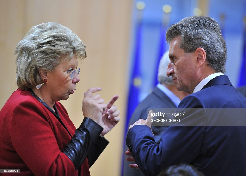 EU commissioner for Energy Gunther Oettinger talks with EU commissioner for Justice, Fundamental Rights and Citizenship Viviane Reding before a working session with Irish government on October 3, 2012 at the EU Headquarters in Brussels as Irland will take the next turn over EU presidency.