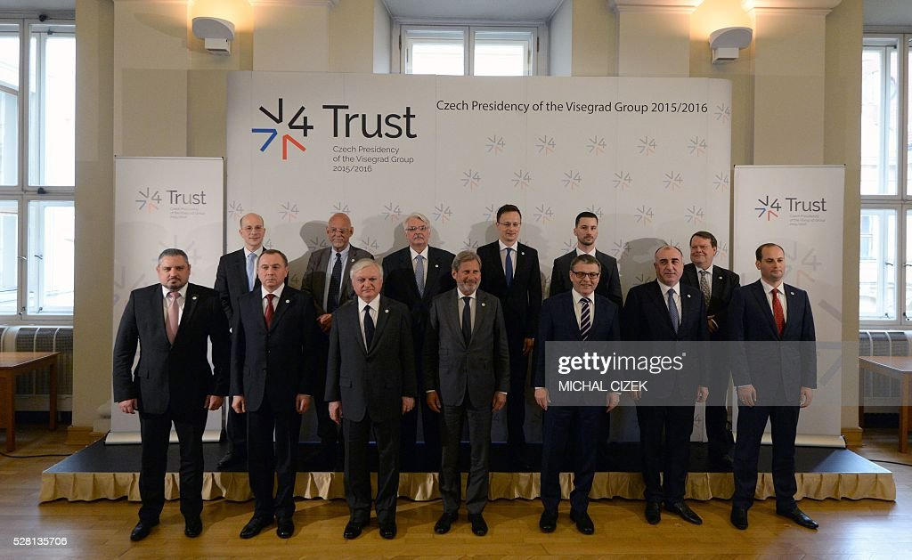 EU commissioner for European Neighbourhood Policy and Enlargement Negotiations Johannes Hahn (front row, C) poses for a family photo with the ministers and deputies during a meeting of Visegrad 4 foreign ministers and their counterparts from six post-Soviet republics on May 4, 2016 in Prague. / AFP / Michal Cizek