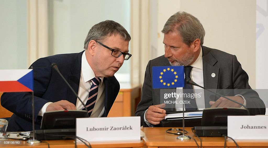 EU commissioner for European Neighbourhood Policy and Enlargement Negotiations Johannes Hahn (R) talks with Czech Foreign Minister Lubomir Zaoralek during a meeting of Visegrad 4 foreign ministers and their counterparts from six post-Soviet republics on May 4, 2016 in Prague. / AFP / Michal Cizek