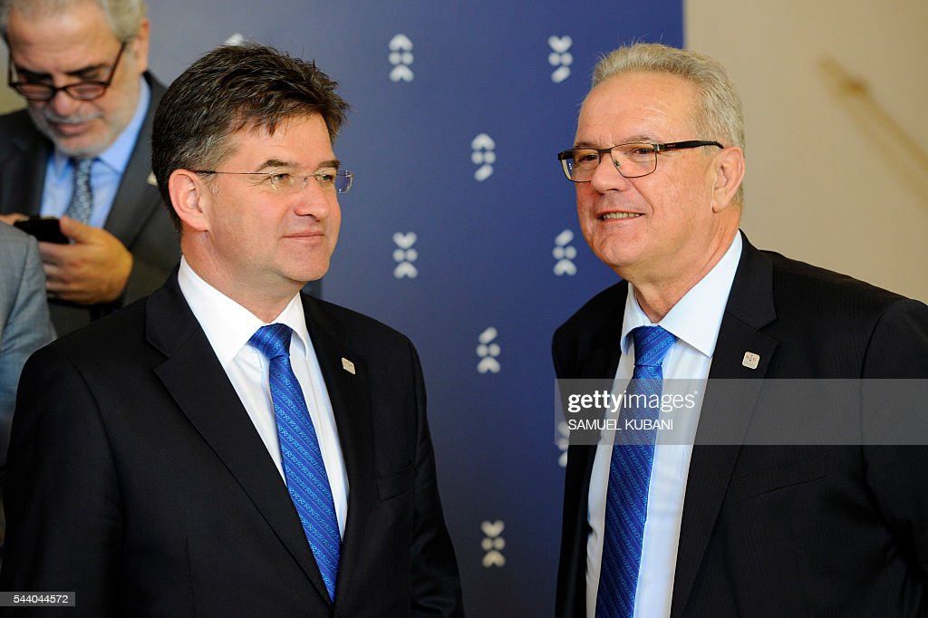 Commissioner for International Cooperation and Development, Neven Mimica (R), talks wit Slovak Foreign Minister Miroslav Lajcak (L), at a photo session, during a visit of the College of European Commissioners, in Bratislava on July 1, 2016. Slovakia assumes the rotating EU presidency. / AFP / SAMUEL