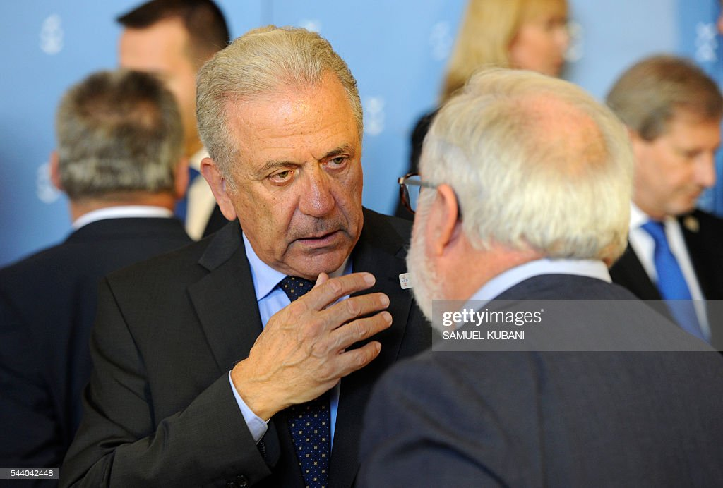 EU Commissioner for Migration, Home Affairs and Citizenship Dimitris Avramopoulos (L) talks with Miguel Arias Canete Commissioner for Climate Action and Energy at a photo session, during a visit of the College of European Commissioners in Bratislava, on July 1, 2016. Slovakia assumes the rotating EU presidency. / AFP / SAMUEL