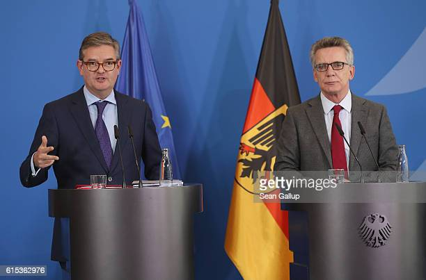 Commissioner for the Security Union Julian King and German Interior Minister Thomas de Maiziere speak to the media following talks on October 18 2016...