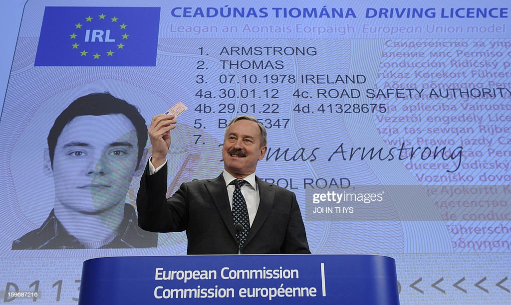 EU Commissioner for Transports Siim Kallas gives a press conference on the European driving licences directive at the EU Headquarters in Brussels on January 18, 2013 in front of a screen displaying the new European driving licence. The new, credit-card style card, which will gradually replace about 300 million driving licences issued by national governments across the European Union, will help 'fight fraud and improve road security,' said a Commission spokeswoman on Thursday. AFP PHOTO / JOHN THYS