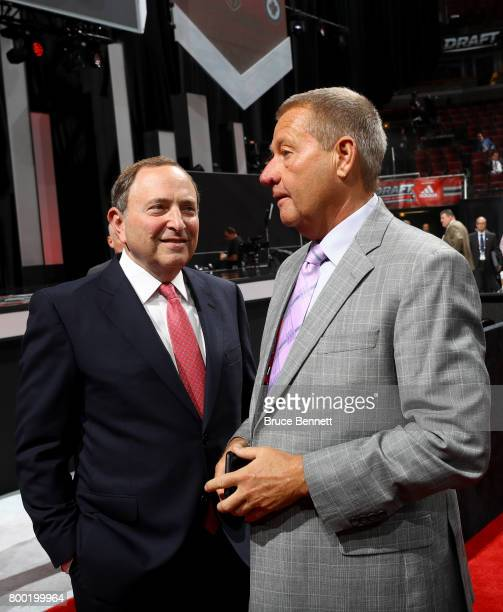 Commissioner Gary Bettman and Florida Panthers executive chairman Peter Luukko meet during the 2017 NHL Draft at the United Center on June 23 2017 in...