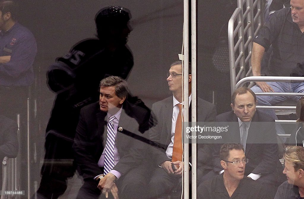 Commissioner Gary Bettman (R) and Los Angeles Kings CEO Tim Leiweke watch the NHL game between the Chicago Blackhawks and the Los Angeles Kings at Staples Center on January 19, 2013 in Los Angeles, California. The Blackhawks defeated the Kings 5-2.
