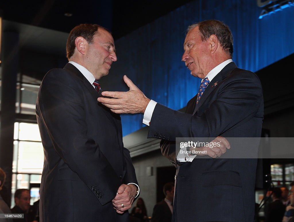 NHL Commissioner Gary Bettman and New York Mayor Michael Bloomberg chat following the announcement of the New York Isalnders move to Brooklyn in 2015 at a press conference at the Barclays Center on October 24, 2012 in the Brooklyn borough of New York City.