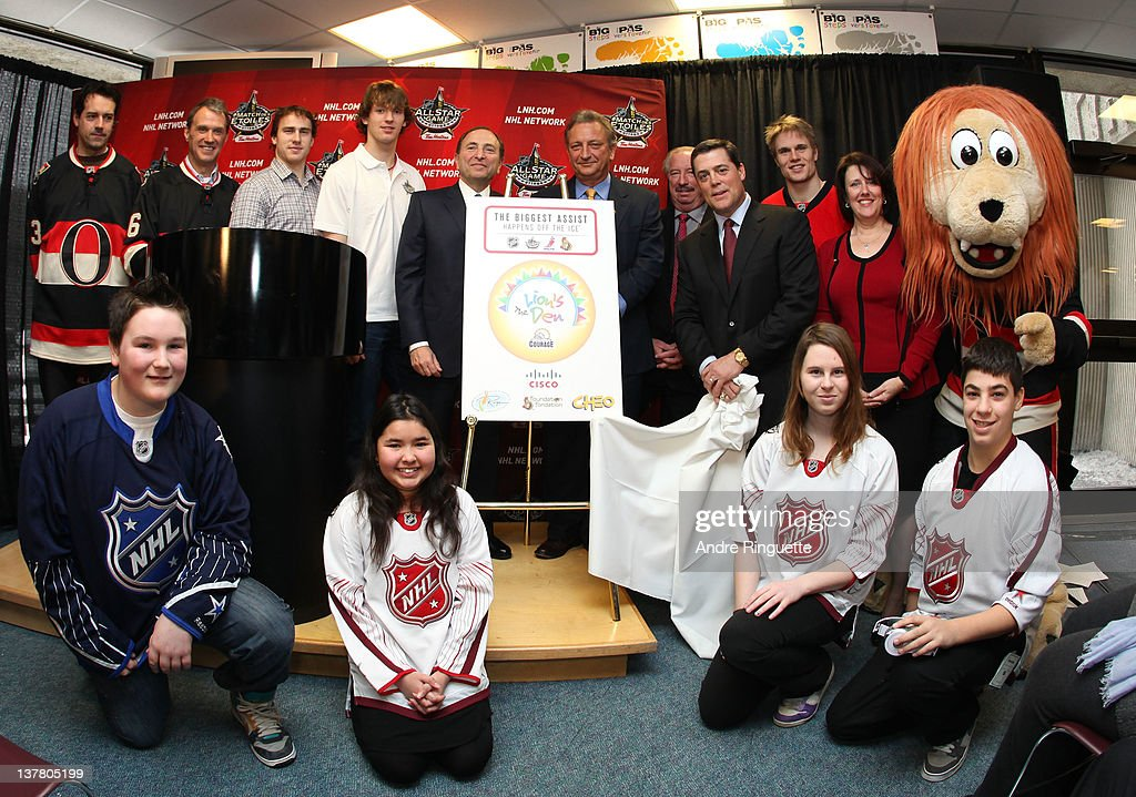 Commissioner Gary Bettman (L of Center) and Ottawa Senators Owner Eugene Melnyk (R of Center) and former NHL player Pat LaFontaine (3rd from R) unveil the NHL All-Star Legacy Playroom at Children's Hospital of Eastern Ontario on January 27, 2012 in Ottawa, Canada.