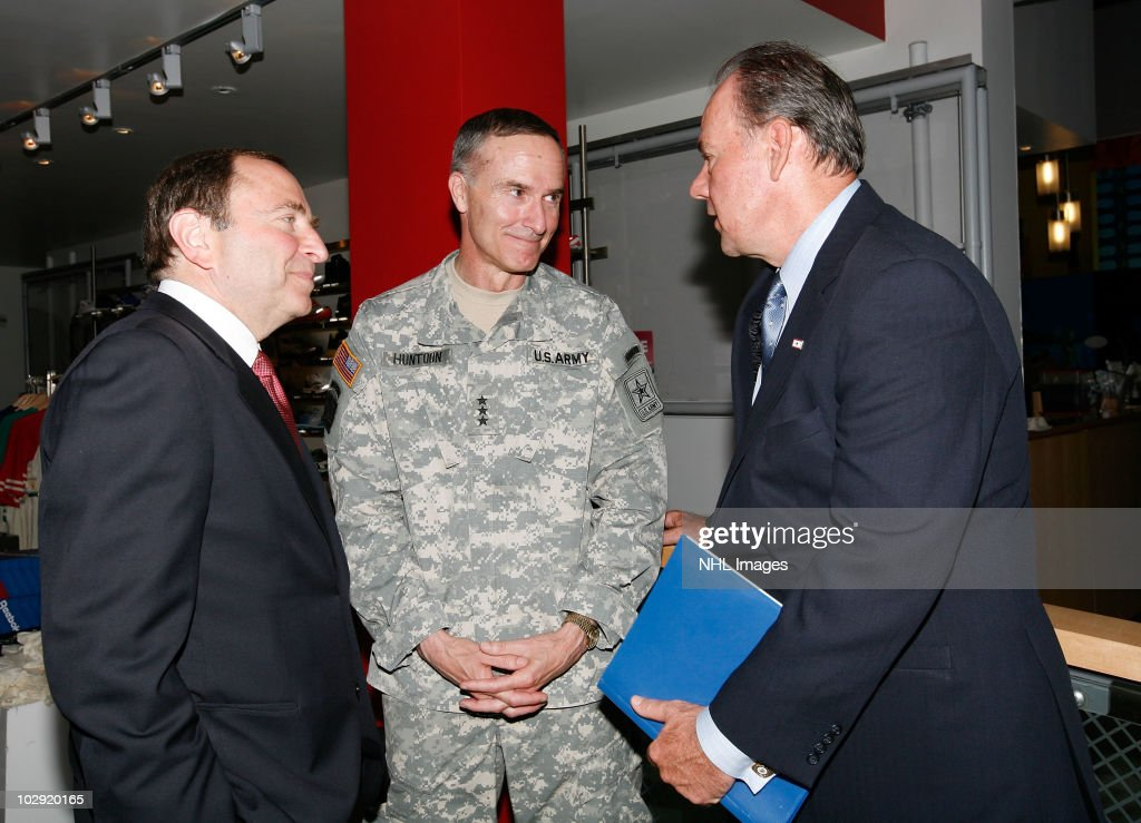 NHL Commissioner <a gi-track='captionPersonalityLinkClicked' href=/galleries/search?phrase=Gary+Bettman&family=editorial&specificpeople=215089 ng-click='$event.stopPropagation()'>Gary Bettman</a>, Lt. Gen. David Huntoon, Jr. and UPS East Region President Glenn Rice speak to each other during the NHL, UPS & U.S. Army Street Hockey Equipment Donation To Troops In Iraq event at the NHL Powered by Reebok Store on June 7, 2010 in New York.