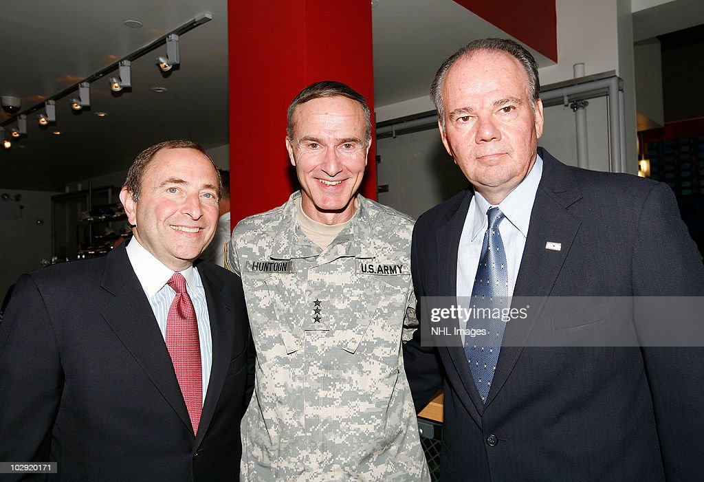 NHL Commissioner <a gi-track='captionPersonalityLinkClicked' href=/galleries/search?phrase=Gary+Bettman&family=editorial&specificpeople=215089 ng-click='$event.stopPropagation()'>Gary Bettman</a>, Lt. Gen. David Huntoon, Jr. and UPS East Region President Glenn Rice pose during the NHL, UPS & U.S. Army Street Hockey Equipment Donation To Troops In Iraq event at the NHL Powered by Reebok Store on June 7, 2010 in New York.