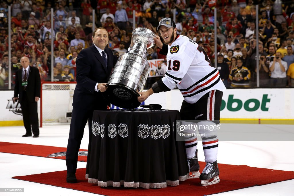 Commissioner <a gi-track='captionPersonalityLinkClicked' href=/galleries/search?phrase=Gary+Bettman&family=editorial&specificpeople=215089 ng-click='$event.stopPropagation()'>Gary Bettman</a> names Patrick Kane #88 of the Chicago Blackhawks the winner of the Conn Smythe Trophy after defeating the Boston Bruins in Game Six of the 2013 NHL Stanley Cup Final at TD Garden on June 24, 2013 in Boston, Massachusetts.