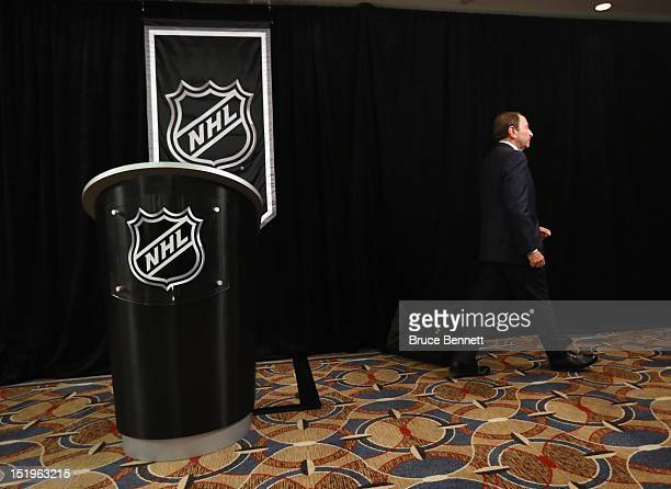 Commissioner Gary Bettman of the National Hockey League leaves the podium after addressing the media at Crowne Plaza Times Square on September 13...