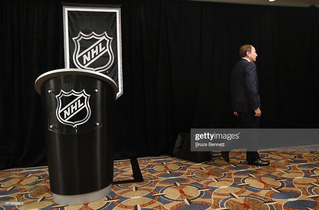 Commissioner <a gi-track='captionPersonalityLinkClicked' href=/galleries/search?phrase=Gary+Bettman&family=editorial&specificpeople=215089 ng-click='$event.stopPropagation()'>Gary Bettman</a> of the National Hockey League leaves the podium after addressing the media at Crowne Plaza Times Square on September 13, 2012 in New York City.