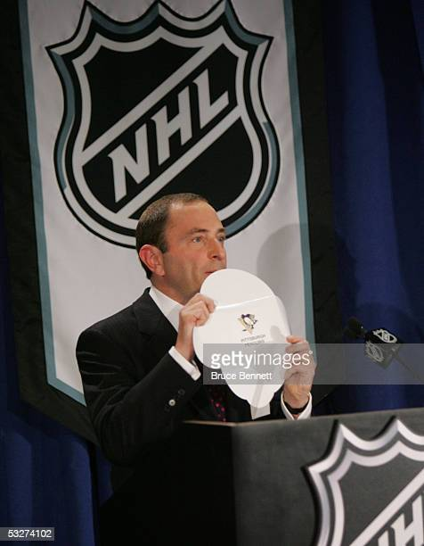 Commissioner Gary Bettman of the National Hockey League presents the Pittsburgh Pengiuns card as the first choice in the 2005 entry draft lottery at...