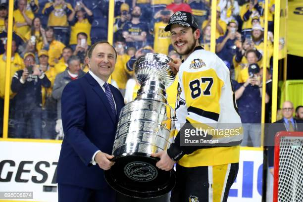 Commissioner Gary Bettman poses for a photo with Sidney Crosby of the Pittsburgh Penguins after they defeated the Nashville Predators 20 to win the...
