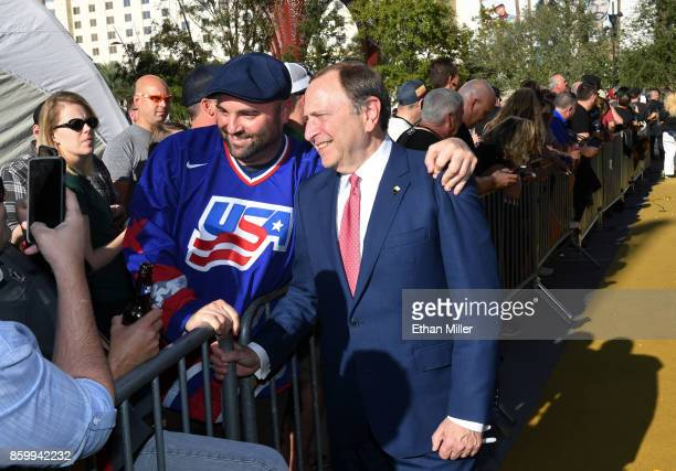 Commissioner Gary Bettman poses with a fan as he arrives at the Vegas Golden Knights' inaugural regularseason home opener against the Arizona Coyotes...