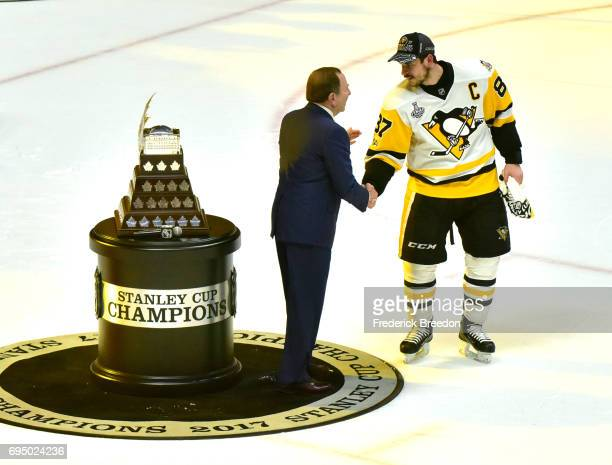 Commissioner Gary Bettman presents Sidney Crosby of the Pittsburgh Penguins with the Conn Smythe Trophy for MVP after his teams 20 win over the...
