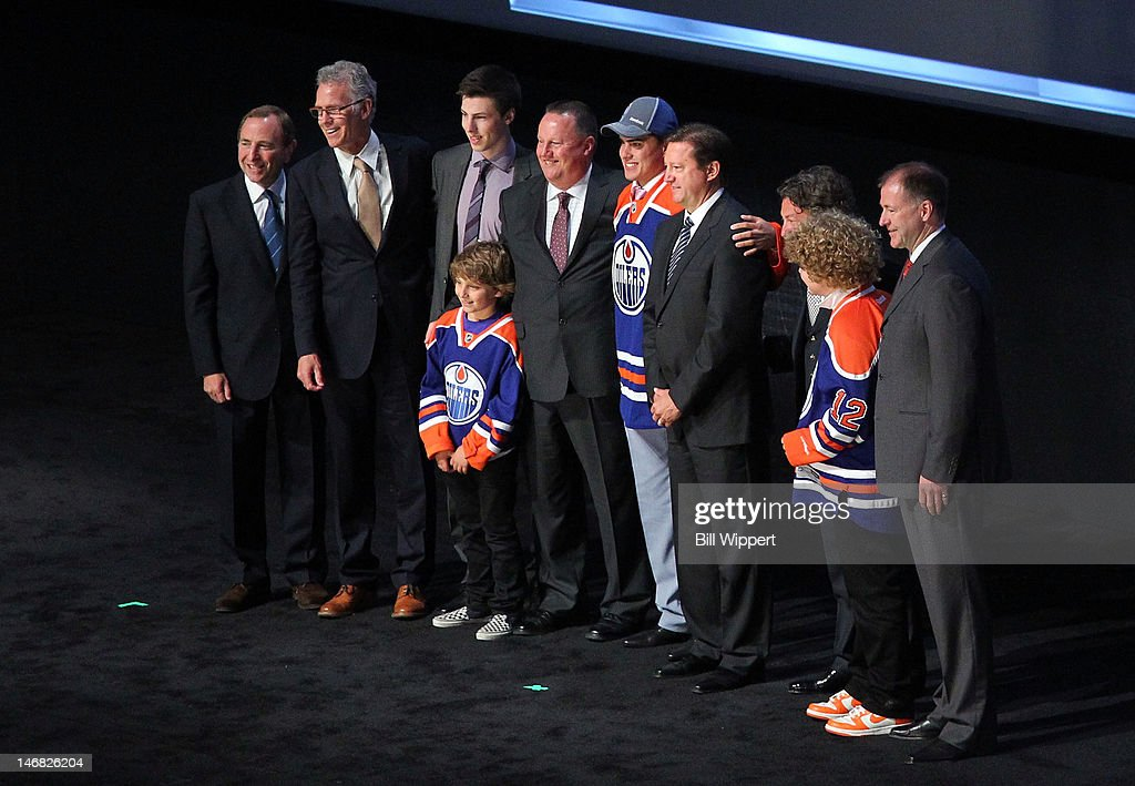 NHL Commissioner Gary Bettman, Senior VP of Hockey Operations Craig MacTavish, 2011 First overall pick Ryan Nugent-Hopkins, Head Amateur Scout Stu MacGregor, first overall pick Nail Yakupov, General Manager Steve Tambellini, Oilers Governor/Owner Daryl Katz and President of Hockey Operations Kevin Lowe pose for a group photo onstage during Round One of the 2012 NHL Entry Draft at Consol Energy Center on June 22, 2012 in Pittsburgh, Pennsylvania.