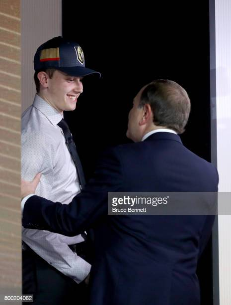 Commissioner Gary Bettman shakes hands with Cody Glass after being selected sixth overall by the Vegas Golden Knights during the 2017 NHL Draft at...