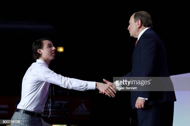Commissioner Gary Bettman shakes hands with Filip Chytil after being selected 21st overall by the New York Rangers during the 2017 NHL Draft at the...