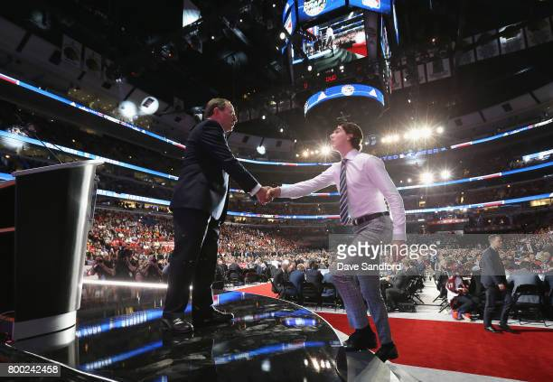 Commissioner Gary Bettman shakes hands with Filip Chytil after he was selected 21st overall by the New York Rangers during Round One of the 2017 NHL...