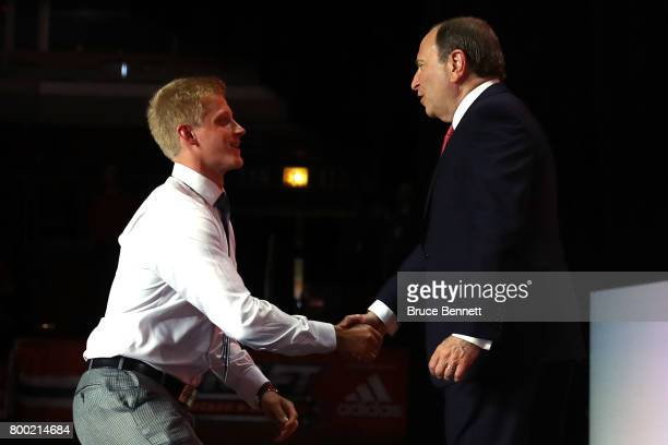 Commissioner Gary Bettman shakes hands with Juuso Valimaki after being selected 16th overall by the Calgary Flames during the 2017 NHL Draft at the...