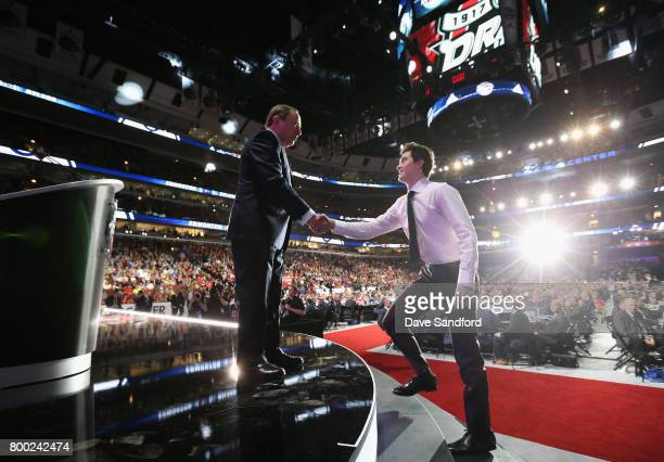 Commissioner Gary Bettman shakes hands with Kailer Yamamoto after he was selected 22nd overall by the New York Rangers during Round One of the 2017...