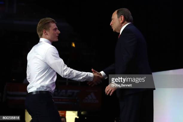 Commissioner Gary Bettman shakes hands with Lias Andersson after being selected seventh overall by the New York Rangers during the 2017 NHL Draft at...