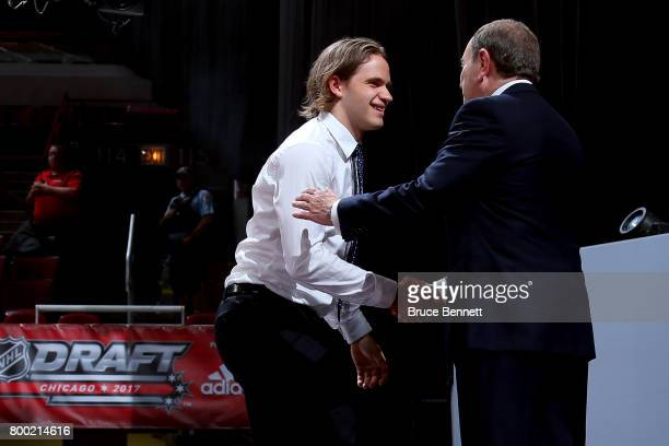 Commissioner Gary Bettman shakes hands with Timothy Liljegren after being selected 17th overall by the Toronto Maple Leafs during the 2017 NHL Draft...