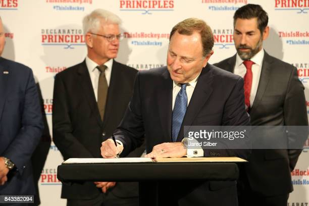 Commissioner Gary Bettman signs the Declaration of Principles during the NHL Declaration of Principles press conference in NYC at Del Friscos on...