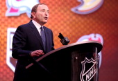 Commissioner Gary Bettman speaks during the first round of the 2014 NHL Draft at the Wells Fargo Center on June 27 2014 in Philadelphia Pennsylvania
