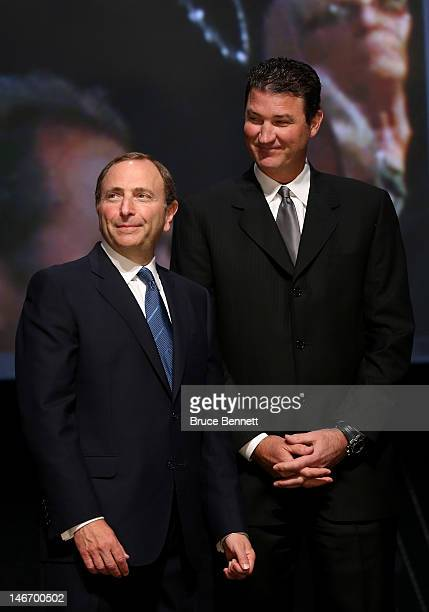 Commissioner Gary Bettman speaks with CoOwner of the Pittsburgh Penguins Mario Lemieux during Round One of the 2012 NHL Entry Draft at Consol Energy...