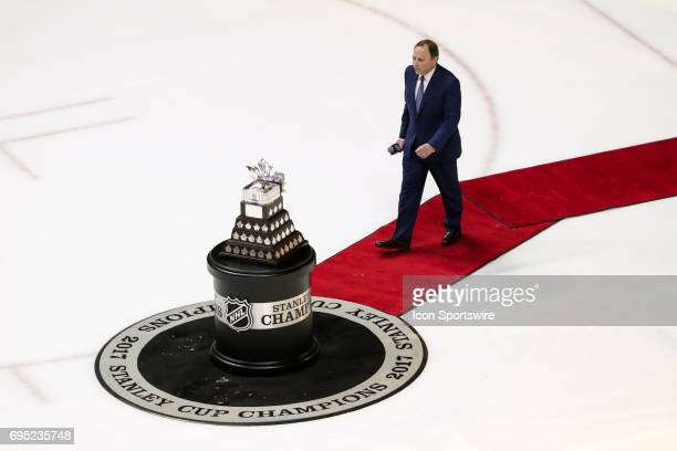 Commissioner Gary Bettman walks towards Conn Smythe Trophy after game 6 of the 2017 NHL Stanley Cup Finals between the Pittsburgh Penguins and...