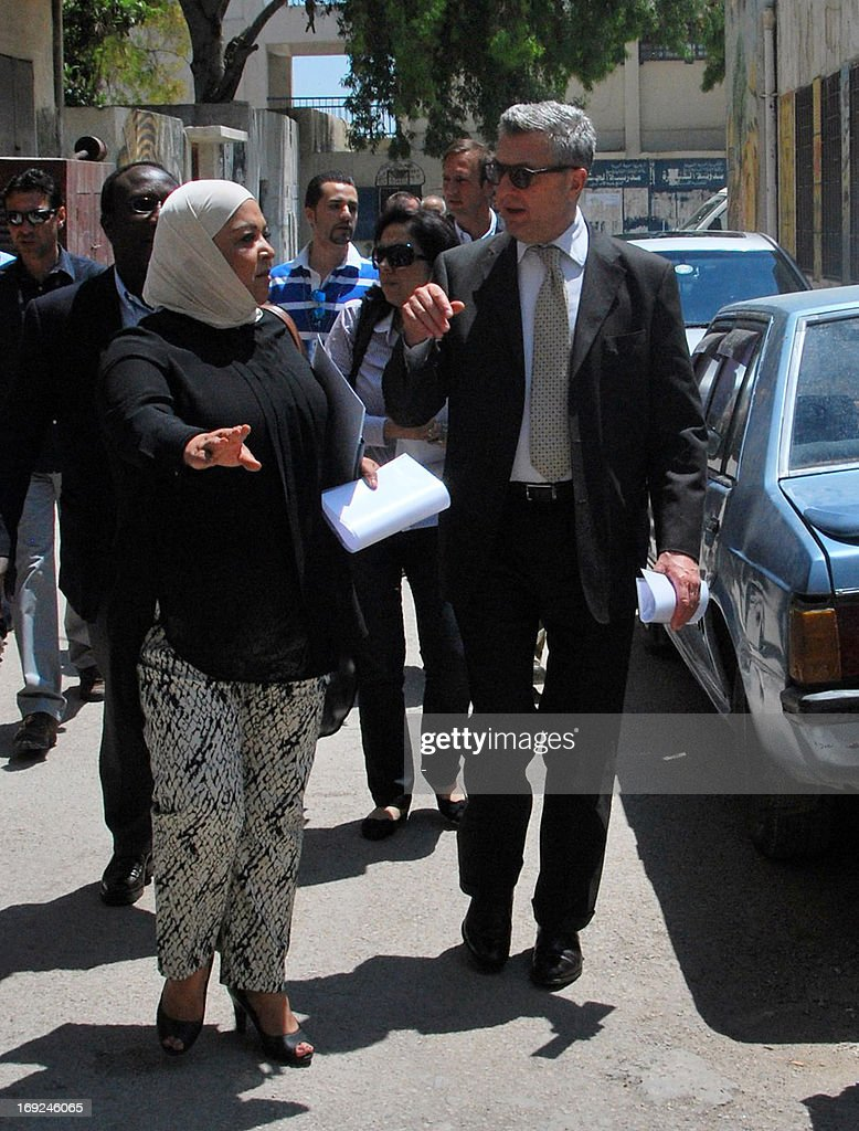 Commissioner General Filippo Grandi arrives for a visit at a camp for Palestinian refugees on May 22, 2013 in Homs, Syria. The conflict in Syria has displaced more than two-thirds of Palestinian refugees living in the country, the UN Relief and Works Agency for Palestine refugees said.