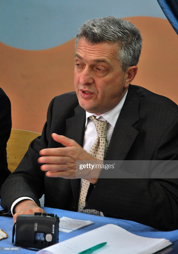 Commissioner General Filippo Grandi speaks to journalists during a visit at a camp for Palestinian refugees on May 22, 2013 in Homs, Syria. The conflict in Syria has displaced more than two-thirds of Palestinian refugees living in the country, the UN Relief and Works Agency for Palestine refugees said.