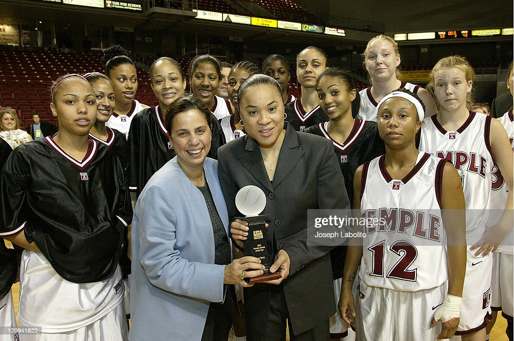 Commissioner Linda Bruno (Blue) and the Temple Womens Basketball Team present the USA Basketball 'Women Athlete of the Year' award to Temple Head Coach <a gi-track='captionPersonalityLinkClicked' href=/galleries/search?phrase=Dawn+Staley&family=editorial&specificpeople=209196 ng-click='$event.stopPropagation()'>Dawn Staley</a> after a Temple Owls 59 to 43 victory over the University of Massachusetts Minutewomen at the Liacouras Ctr in Philadelphia, Pennsylvania on January 4, 2005