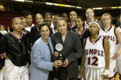 Commissioner Linda Bruno and the Temple Womens Basketball Team present the USA Basketball 'Women Athlete of the Year' award to Temple Head Coach Dawn...