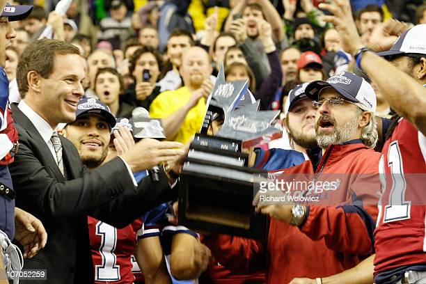 Commissioner Mark Cohon presents the Eastern Division trophy to Montreal Alouettes General Manager Jim Popp during the CFL Eastern Finals game...