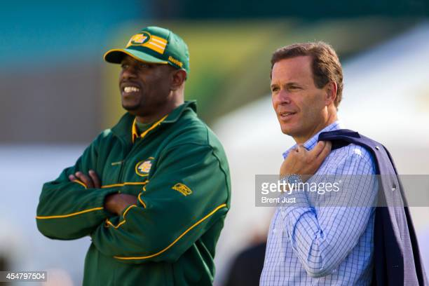 Commissioner Mark Cohon watches from the sidelines before the game between the Calgary Stampeders and Edmonton Eskimos in week 11 of the 2014 CFL...