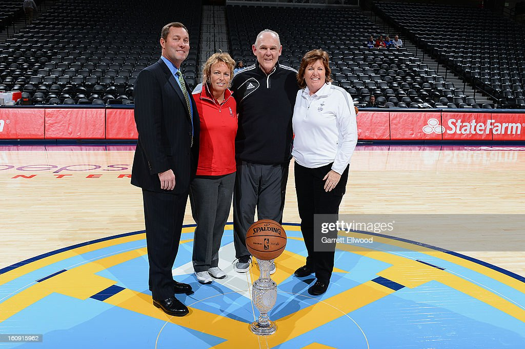 Commissioner Mike Whan, Dottie Pepper, George Karl of the Denver Nuggets, and U.S. Team Captain Meg Mallon take a picture with the Solheim Cup before the game against the Chicago Bulls on February 7, 2013 at the Pepsi Center in Denver, Colorado.