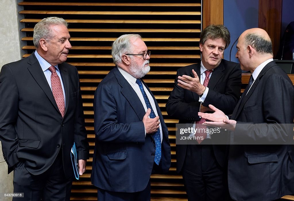 EU Commissioner of Financial Stability, Financial Services and Capital Markets Union Jonathan Hill (2nd R) speaks with EU Commissioner of Economic an d Financial Affairs, Taxation and Customs Pierre Moscovici (R) and EU Commissioner of Migration and Home Affairs Dimitris Avramopoulos (L) and EU Commissioner of Climate Action and Energy Miguel Arias Canete (2nd L) during a Commissioners college meeting at the EU headquarters in Brussels on June 27, 2016. In an early sign of the Brexit fallout in Brussels, Britain's European commissioner for financial services, Jonathan Hill, said he would stand down. / AFP / JOHN