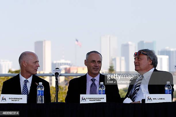 Commissioner of Major League Baseball Robert D Manfred Jr talks with Marlins owner Jeffrey Loria and State of Florida Governor Rick Scott during the...