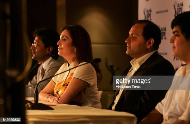 Commissioner of the Indian Premier League Lalit Kumar Modi along with coowner of 'Mumbai Indians' cricket team Neeta Ambani addresses a press...
