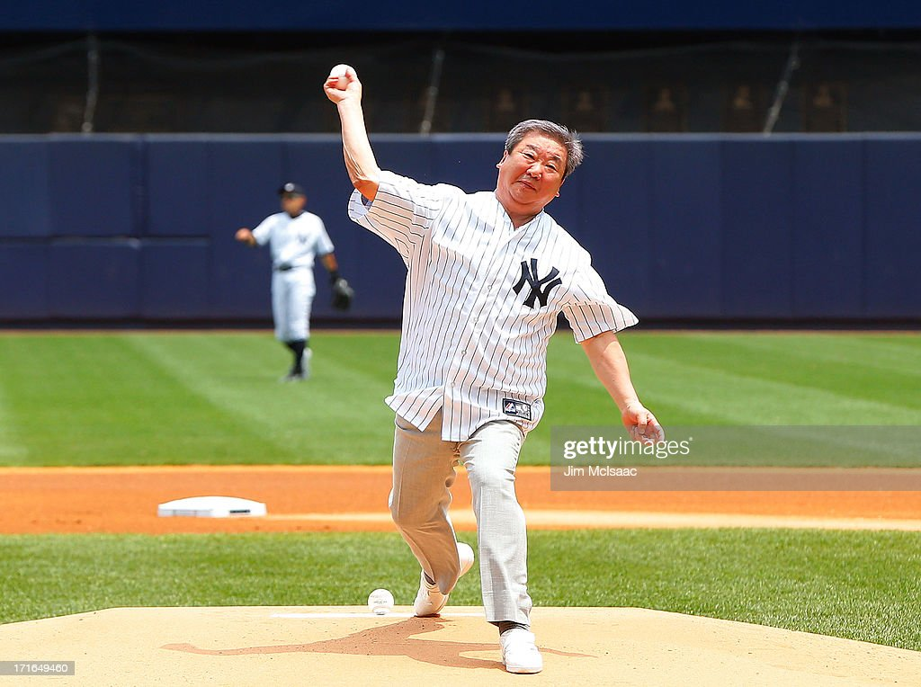 Commissioner of the Korean Baseball Organization Koo Bon-Nueng throws the ceremonial first pitch before a game between the New York Yankees and the Texas Rangers at Yankee Stadium on June 27, 2013 in the Bronx borough of New York City.