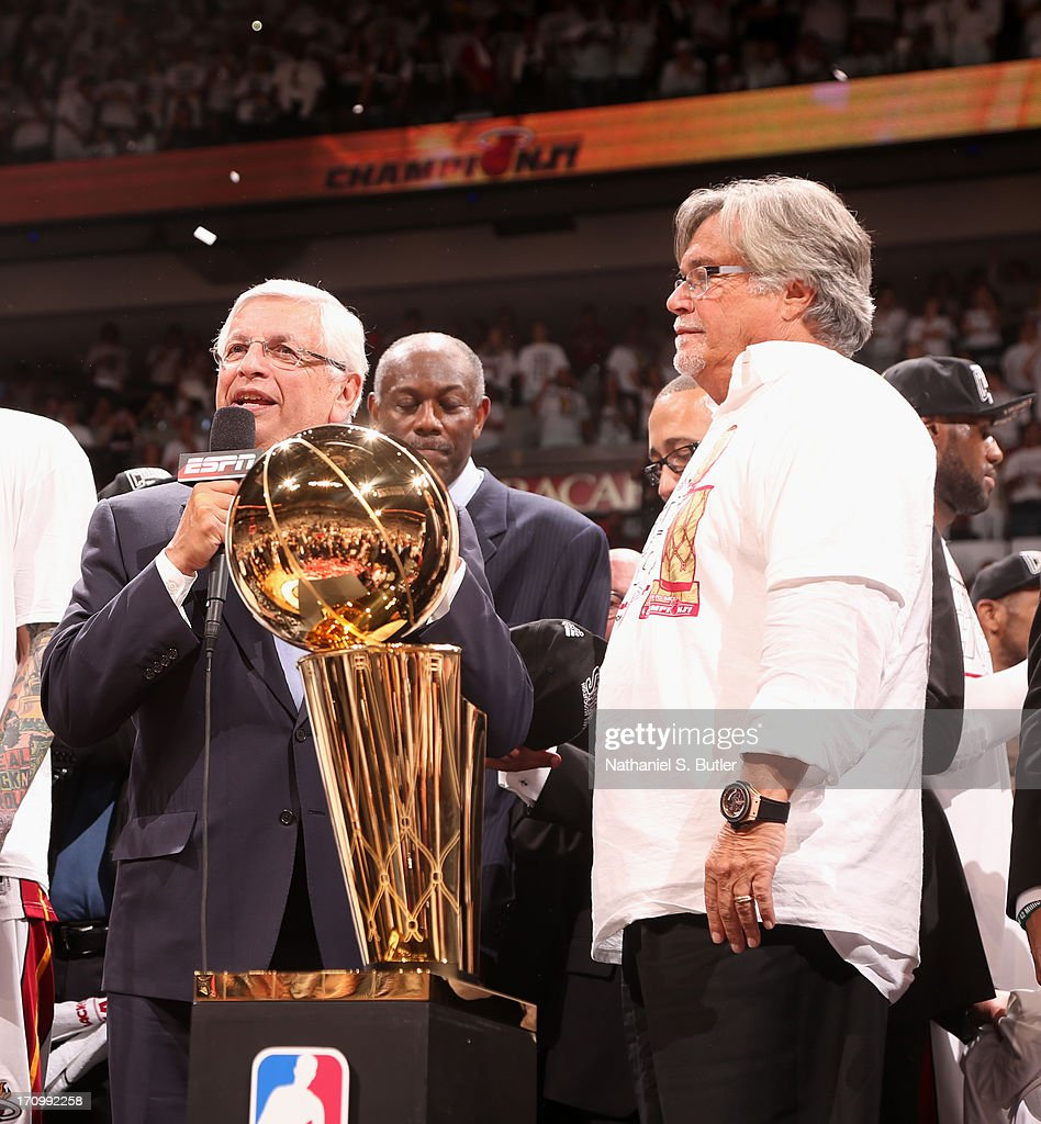 Commissioner of the National Basketball Association David Stern presents the owner of the Miami Heat Micky Arison with the Larry O'Brien Championship...